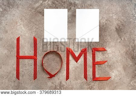 Word Home Made From Red Ribbon And Blank Paper Card Mockup On Beige Grunge Background. Invitation Ca