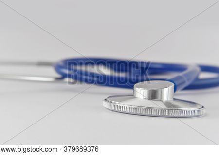 Blue Stethoscope Medical Tool On White Background. Idea For Doctor Diagnostic Coronavirus Disease.