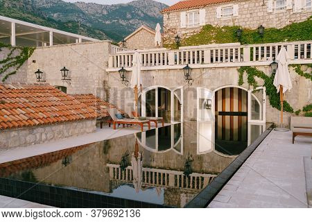 Mirror Reflection In The Swimming Pool In The Old Villa.