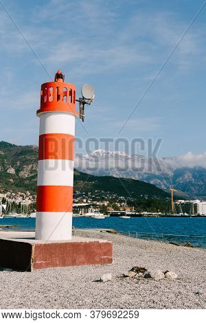 Striped Red And White In Tivat, Montenegro. Against The Snow-covered Top Of Mount Lovcen.