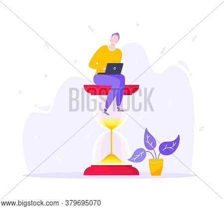 Time Managemet Business Concept Metaphor. Happy Young Adult Man Sitting On Hourglass And Working On