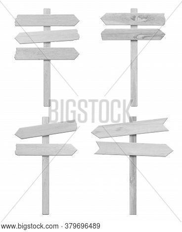 4 White Wood Arrow Sign Isolated On White Background. Object With Clipping Path.