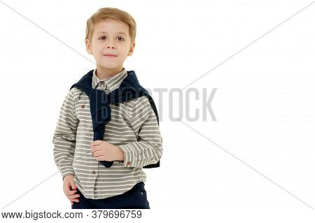 Handsome Little Boy In Full Growth On A White Background. The Concept Of Advertising, Happy Childhoo
