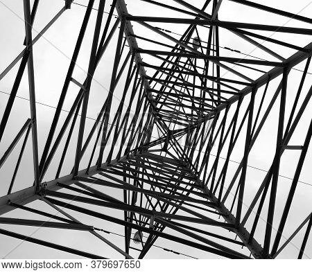 Electricity Pole Symmetrical And Abstract Lines Bottom-up Perspective.