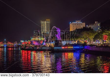 Da Nang, Vietnam, 25.07.2020: Night On Da Nang Waterfront, Lit Tree With Hearts. Dragon River Bridge