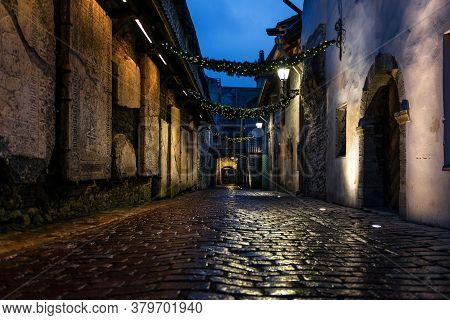 Night View Of St. Catherine's Passage In Tallinn, Estonia, A Medieval Passage Containing Some Of The