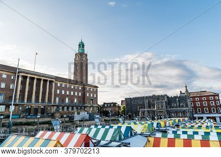 Wide-angle View Of The Colourful Rooftops On Norwich Market, With The Medieval Guildhall In The Back