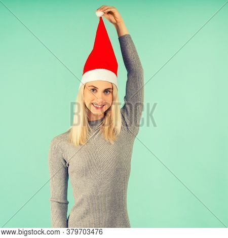 A Beautiful Sexy Girl In Gray Dress, Hold In Handsa New Year's Hat. Celebration Of Christmas Or New