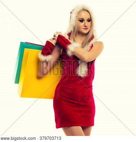 A Beautiful Sexy Woman In A New Year's Dress, Hold In Hands Shopping Bags Isolated On White. Celebra