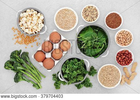 Health food for energy, vitality & fitness with vegetables, nuts, seeds, legumes, grains, cereal  & dairy. Foods high in vitamins, minerals, antioxidants, smart carbs, protein & omega 3. Flat lay.