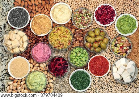 Vegan health food for clean eating with foods high in protein, omega 3, smart carbs, anthocyanins, vitamins, minerals, antioxidants and fibre. Sustainable ethical eating concept. Flat lay.