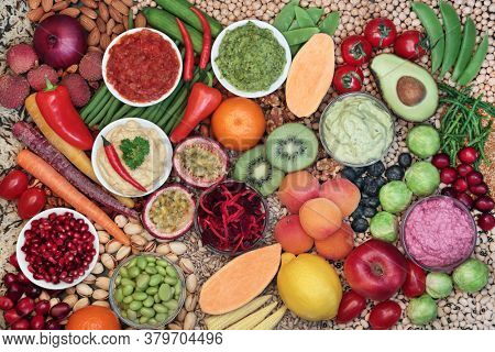 Health food for vegan eating with foods high in protein, anthocyanins, vitamins, minerals, omega 3, smart carbs, antioxidants and fibre. Healthy ethical eating concept.  Flat lay.