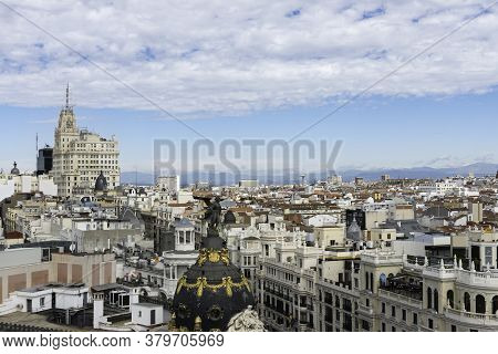 Aerial View Of Gran Vía And Madrid's Skyline On A Summer Early Morning, With The Metropolis Building