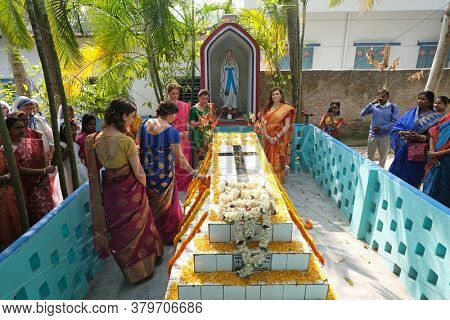 KUMROKHALI, INDIA - FEBRUARY 23, 2020: Pilgrims from Croatia at the Tomb of the Croatian Missionary, Jesuit Father Ante Gabric on the occasion of his 105th birthday in Kumrokhali, West Bengal, India