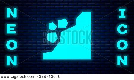 Glowing Neon Landslide Icon Isolated On Brick Wall Background. Stones Fall From The Rock. Boulders R
