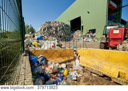 Large Heap Of Garbage Inside A Processing Plant