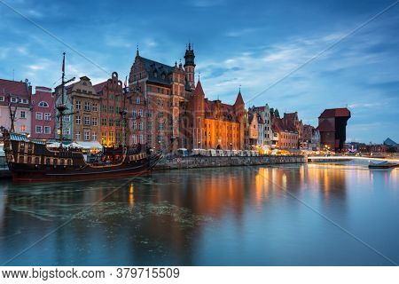 Amazing architecture of Gdansk old town at night with a new footbridge over the Motlawa River. Poland