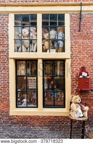 Amsterdam, The Netherlands - December 11, 2012: Small Shop Showcase With Old Toys In Amsterdam.