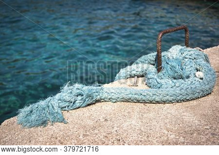 Close-up Photo Of Light Blue Fishing Ropes On The Waterfront.
