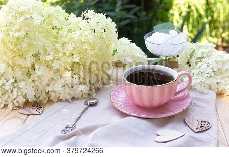 Composition With Cup Of Tea, Sugar In Bowl And Hydrangea Flowers On Rustic Napkin On The Table