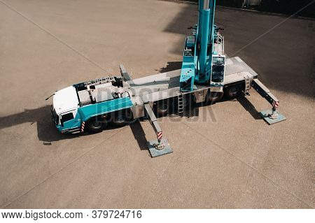 View From The Height Of The Car Heavy Crane That Stands Open In The Parking Lot And Ready To Work. T