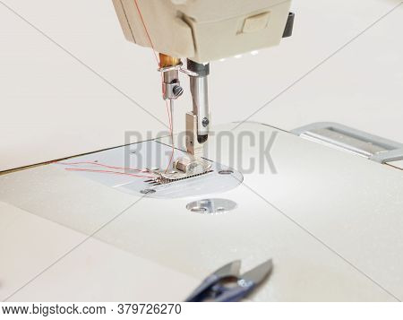 Close Up Of Sewing Process On The Overlock In The Sewing Shop. Tailoring Industry.. Interior Of Garm
