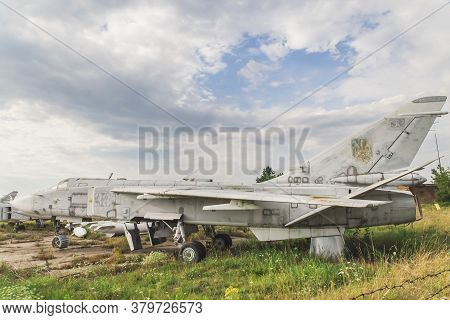 White Church, Ukraine, July 2020: Old Ukrainian Jet Fighter Su 24 At The Abandoned Airfield