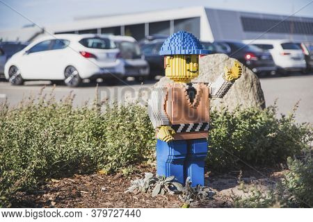 Billund, Denmark, July 2018: Plastic Man In The Parking Lot Of Legoland Amusement Park
