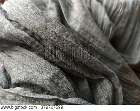 Curtains Or Tulle In The Scandinavian Style. Gray Pleated Fabric Or Wrinkled Textile Hangs Down. Clo