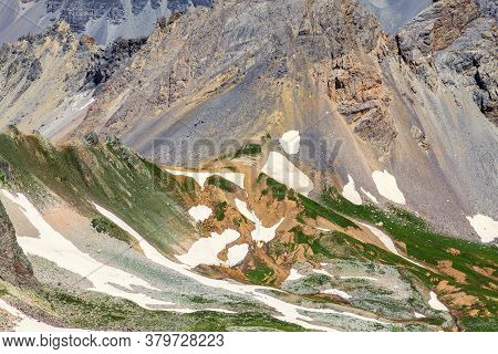 Aerial View Of The Relief Of High Altitude Mountains At The Col Du Vallon (left) Which Separate The