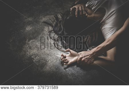 Man's Hand Holding A Woman Hand For Rape And Sexual Abuse. Hands For Rape And Sexual Abuse Concept.