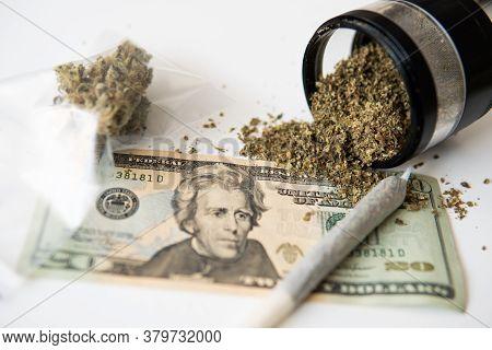 Marijuana Bud And Banknotes Of Dollars. Money Weed. Cannabis In Economics. Cbd Thc Herb. The Pot Bud