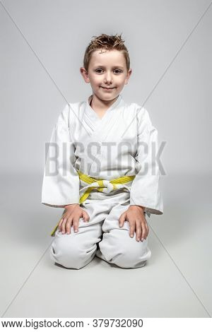 martial arts child sitting in traditional Japanese form.