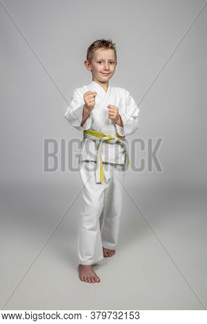 martial arts, a child with judogi in a guard position.