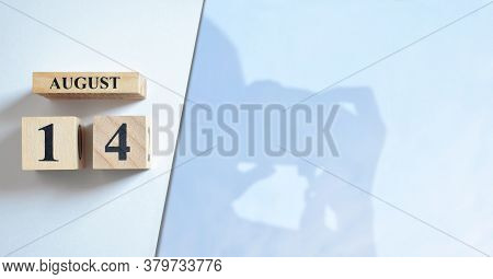August 14, Shadow Of Photographer With Number Cube.
