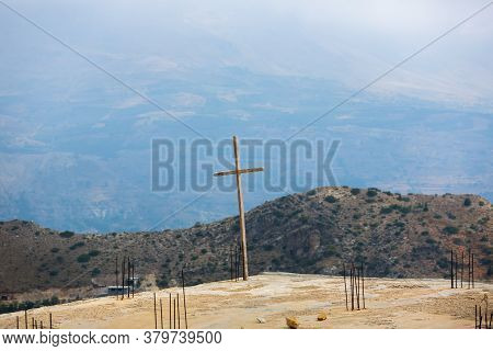 Religious Cross On The Background Of Mountains In The Kadisha Valley In Lebanon. Construction Of The