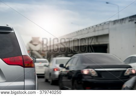 Silver Car On The Road In Traffic Junction There Are Many Cars On The Road. With Different Levels Of