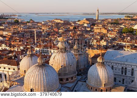 Panoramic View Of Venice, Italy. A Bird's Eye View Of The Domes Of The Cathedral Of San Marco.