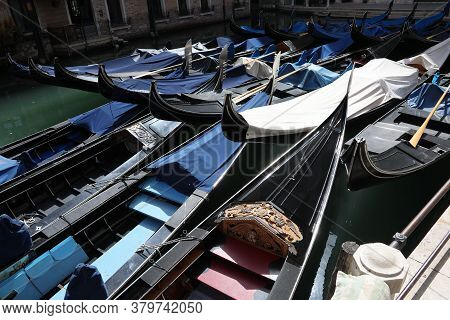Many Moored Gondolas Without Tourists And Because Of The Coronavirus In Venice In Italy