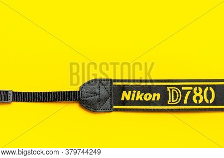 Moscow, Russia - July 15, 2020: Strap From Modern Slr And Mirrorless Camera Nikon D780 Fx On Yellow