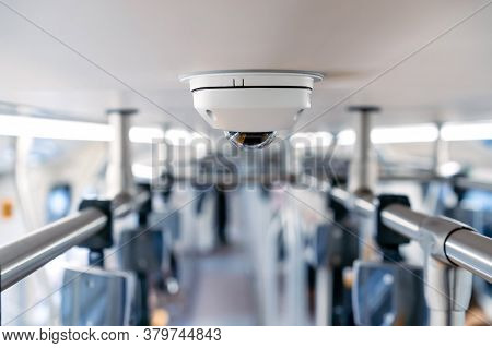 Close Up To Cctv Backside From Top View In The Inside Of The Train With Blur Background.
