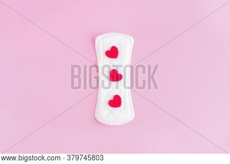 Sanitary Pad On A Pink Background. An Alternative Choice Of Feminine Hygiene Products. Menstrual Mot