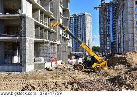 Telescopic Handler Work At The Construction Site. Construction Machinery For Loading. Tower Crane Du