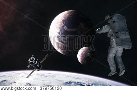 Astronaut, Space Station Orbiting Planet In Deep Space. Science Fiction. Elements Of This Image Furn