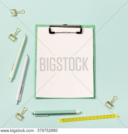 Paper Tablet With Clip And Stationery. Back To School Concept. Blue And White Colored Pens, Yellow R