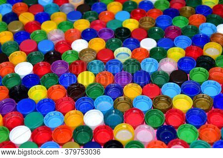 Plastic Bottle Caps Background. Waste Cap Material Is Recyclable. Plastic Lids From Hdpe For Recycle
