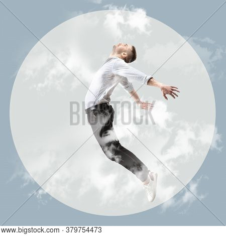 Mid-air Beauty Cought In Twilight. Full Length Shot Of Young Man Hovering In Air And Keeping Eyes Cl