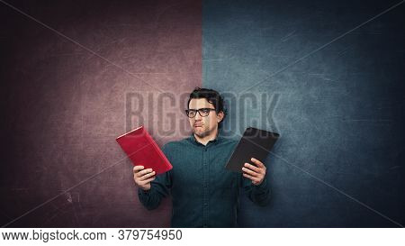 Pensive Male Student Chooses Between A Traditional Book And Electronic Pc Tablet Over A Split Wall W