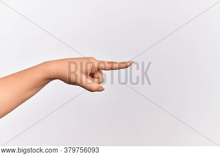 Hand of caucasian young woman pointing with index finger to the side, suggesting and selecting a choice