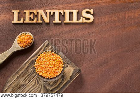 Raw Lentils In The Bowl - Lens Culinaris. Wooden Background